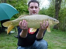 A photograph of 11.5lb common carp that was caught near the spit on the main lake. It gave a good fight and almost lost around a tree, but was subdued after 10 mins. of hard struggle