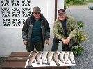 Two anglers with the results of a fine days Trout Fishing, including Trout to 6lb