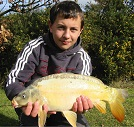 Young Thomas Baker from Tredegar, Gwent with a nice 8 1/2lb Ghost Mirror from the House Pool