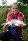 A proud youngster shows off his catch of a lovely skimmer Bream