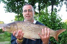Nick Clements with a floating bread caught 12lb 10oz Common Carp from the Main Lake