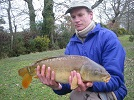 Nick with one of his many Carp caught using simple gear and floating bread or small plain dog biscuit