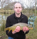 A photograph of Lee Burke of Lampeter with his first ever Carp of 3 1/4lb from the House Pool