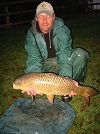 A photograph of Nick with an 11lb Common from the Main Lake