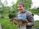 A photograph of an 10lb Mirror caught on bait banded Chum Mixer pellets by young Mr White