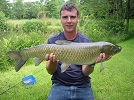 Local angler Mark shows off his prowess at catching and landing a quality 15lb Grassie