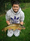 young Mr Moggsy with his fly caught 8lb Mirror