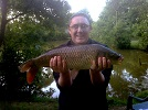 A 12lb Common Carp caught by local angler Jason Denson using floating bread in the Main Lake near to the inflow