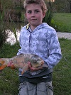 Kyle as he proudly presents one of many good Carp caught by him and his Dad at Nineoaks