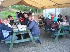 Members of a local Young Farmer's club enjoying burgers and sausages after a thoroughly enjoyable evening