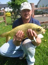 Visiting Angler with a lovely Koi Carp