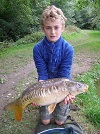 visiting angler lands excellent Carp from Main Pool